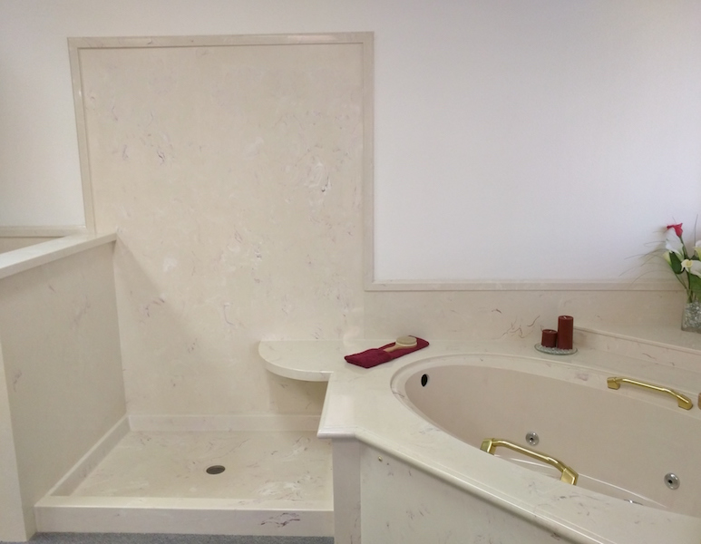 cultured stone jetted tub and shower combo
