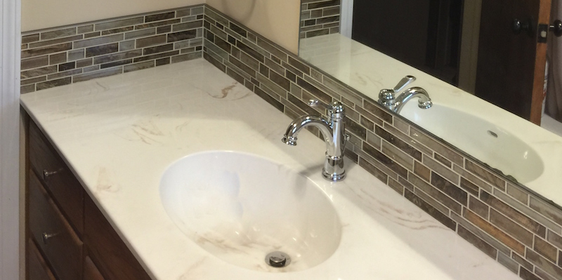 cultured stone vanity with seperate backsplash