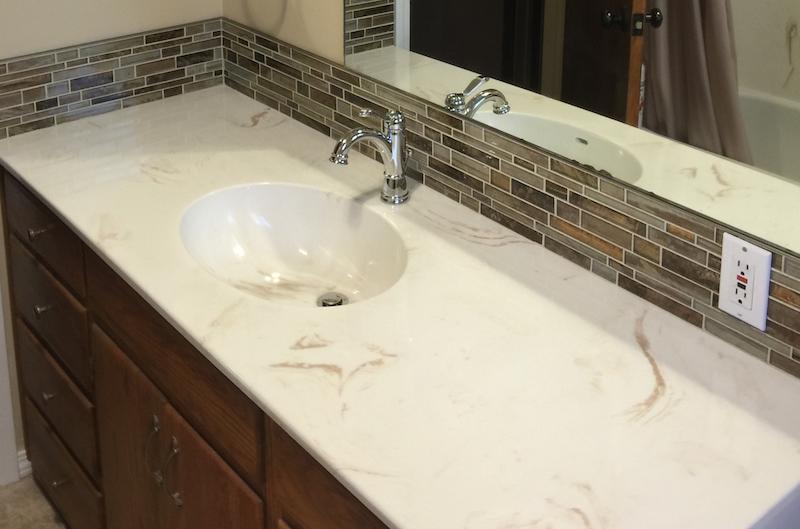 cultured stone vanity with seperate backsplash
