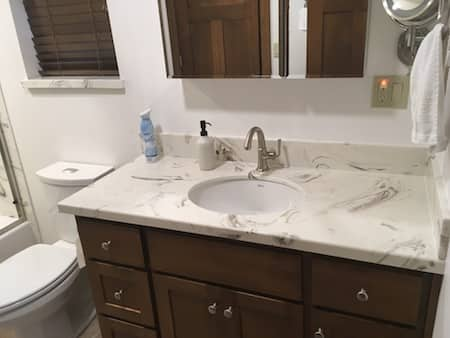 Vanity installed with cultured marble